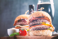 Hamburger and dark beer in vintage style Royalty Free Stock Photos