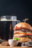 Hamburger and dark beer in vintage style Royalty Free Stock Images
