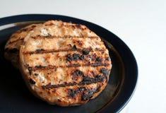Hamburger di color salmone Immagine Stock