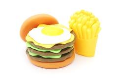 Hamburger di plastica del giocattolo con l'uovo sulla cima Immagine Stock Libera da Diritti