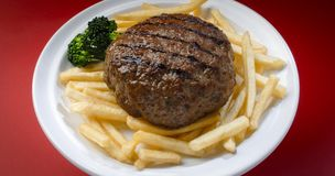 Hamburger. Dish with french fries and broccoli royalty free stock photography