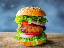 Hamburger do bife de costeleta da carne de porco Fotografia de Stock