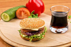 Hamburger with drink Stock Images