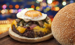 Hamburger. Egg and city lights backgorund Stock Photos