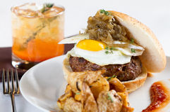 Hamburger with Egg. Plated meal of hamburger with egg and onions Stock Images