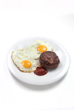 Hamburger and eggs Stock Photo