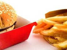 Hamburger en Gebraden gerechten in Karton Royalty-vrije Stock Foto's