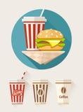 Hamburger et soude dans des tasses de papier Photos stock