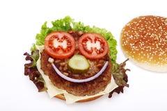 Hamburger with face Royalty Free Stock Image