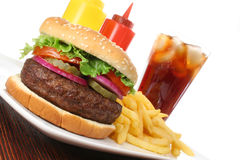 Hamburger fast food meal with fries and drink Royalty Free Stock Images