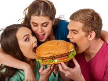 Hamburger fast food in people friends hands . Royalty Free Stock Image