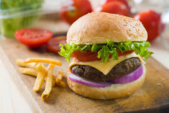 Hamburger fast food with plenty of raw materials on the backgrou Royalty Free Stock Photo