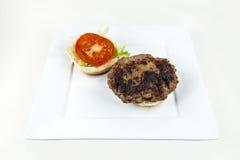 Hamburger. A hamburger with fixings on a bun Royalty Free Stock Image