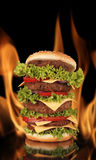 Hamburger in flames Stock Image