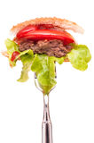 Hamburger on a fork Stock Image