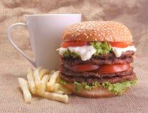 Hamburger francuscy dłoniaki i filiżanka, Zdjęcie Stock