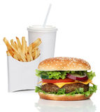 Hamburger with french fries and a cola drink. Isolated on white Stock Photos
