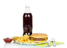Hamburger, french fries, cola, sauces and cutlery isolated on white. Background Stock Image