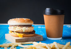 Hamburger, french fries and cola. On wood  background Royalty Free Stock Photos