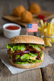 Hamburger with french fries and fried balls Royalty Free Stock Photos