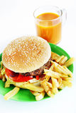 Hamburger with French fries in the plate and juice Royalty Free Stock Image