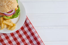 Hamburger and french fries in plate Stock Photos