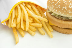Hamburger and french fries on white background Royalty Free Stock Photos