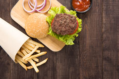 Hamburger with french fries on wooden background Stock Photo