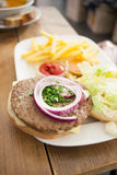 Hamburger with french fries. On wooden desk Stock Photography