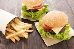 Hamburger with french fries on wooden table Stock Photography