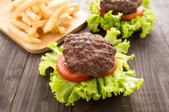 Hamburger with french fries on wooden table Stock Image