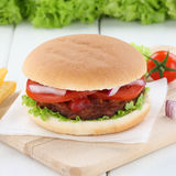 Hamburger fresh beef onion tomatoes lettuce Royalty Free Stock Photography