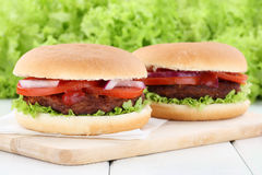 Hamburger fresh beef tomatoes lettuce Royalty Free Stock Photos