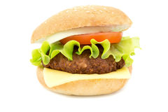 Hamburger with fresh leaf lettuce cheese slice chop tomatoes and onion rings isolated on white Stock Photos
