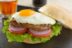 Hamburger with fried egg Royalty Free Stock Image