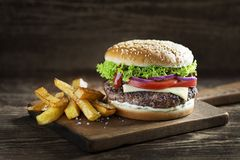 Hamburger with fried potatoes royalty free stock photo