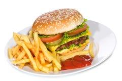 Hamburger with fries Stock Photos