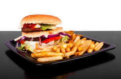 Hamburger with fries  on black and white background Royalty Free Stock Photos
