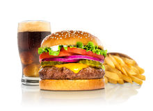 Hamburger fries and a coke soda pop cheeseburger combination deluxe fast food on white. Giant perfect burger large massive thick classic american cheeseburger stock photo