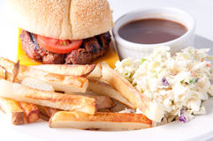Hamburger with fries, cole slaw, and gravy Royalty Free Stock Images