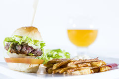 Hamburger with fries Stock Images