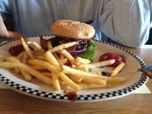 Hamburger and fries at diner Royalty Free Stock Images
