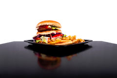 Hamburger with fries isolated on black and white background Stock Photography