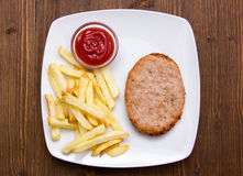Hamburger with fries and ketchup on wood from above Stock Photo