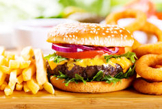 Hamburger with fries and onion rings Stock Photography