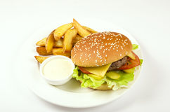 Hamburger. With fries and sauce Royalty Free Stock Photos
