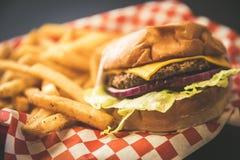 Hamburger and Fries. A serving of Hamburger and Fries royalty free stock photos