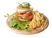 Hamburger, gebraden gerechten en een metende band. Royalty-vrije Stock Afbeeldingen