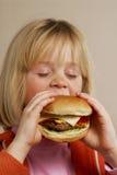 Hamburger girl. Royalty Free Stock Images