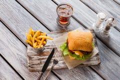 Hamburger and glass of cola. Royalty Free Stock Photo